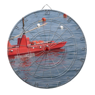 Rowed rescue catamaran at sea dartboard with darts