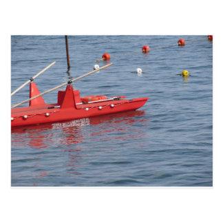 Rowed rescue catamaran at sea postcard