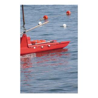 Rowed rescue catamaran at sea stationery