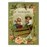 Rowing del muchacho y del chica del vintage en un  felicitaciones