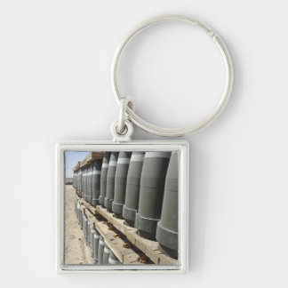 Rows of ammunition are stacked and prepped Silver-Colored square keychain
