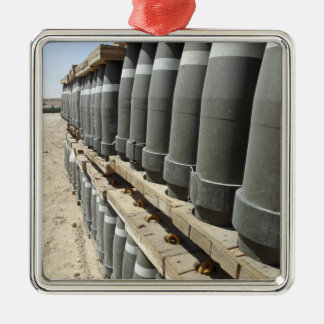 Rows of ammunition are stacked and prepped metal ornament