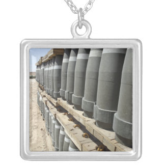 Rows of ammunition are stacked and prepped silver plated necklace