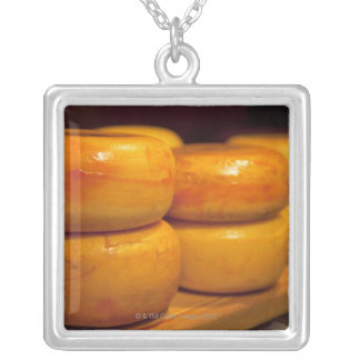 rows of colourful yellow Edam cheeses lined up Silver Plated Necklace