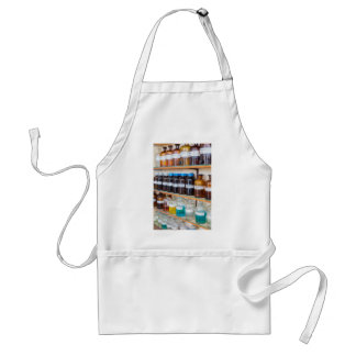 Rows of fluid chemicals in bottles at chemistry adult apron