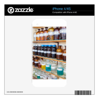 Rows of fluid chemicals in bottles at chemistry iPhone 4 skins