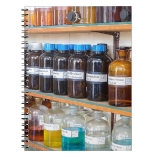 Rows of fluid chemicals in bottles at chemistry spiral notebook