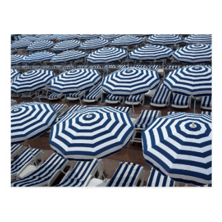 Rows Of Striped Beach Umbrellas With Sun Beds Postcard