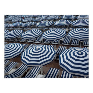 Rows Of Striped Beach Umbrellas With Sun Beds Poster