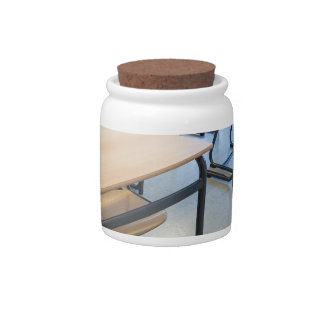 Rows of tables and chairs in classroom candy jar