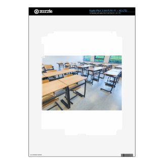 Rows of tables and chairs in classroom iPad 3 skin