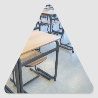 Rows of tables and chairs in classroom triangle sticker