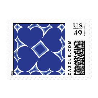Royal blue hearts tile pattern postage stamp