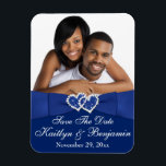 """Royal Blue White Hearts Save the Date Photo Magnet<br><div class=""""desc"""">This royal blue and white photo save the date magnet has a PRINTED blue satin ribbon and bow on it, with a pair of PRINTED diamond jewel and FAUX glitter (simulated) joined hearts on it that matches the wedding invitation shown below. The text is customizable. Upload your own SQUARE digital...</div>"""