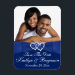 "Royal Blue White Hearts Save the Date Photo Magnet<br><div class=""desc"">This royal blue and white photo save the date magnet has a PRINTED blue satin ribbon and bow on it, with a pair of PRINTED diamond jewel and FAUX glitter (simulated) joined hearts on it that matches the wedding invitation shown below. The text is customizable. Upload your own SQUARE digital...</div>"
