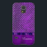 "Royal Purple Silver Gem Personalized Case For Galaxy S5<br><div class=""desc"">This pretty case features a faux silver gem studded top over a background of dramatic deep royal purple abstract background that practically glows. A faux purple ribbon bordered in black separates the two sections. Elegant and classy! * Please note - the image is printed on the case, and does not...</div>"
