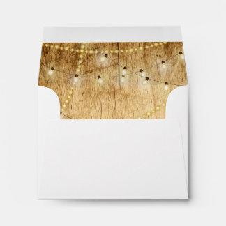 RSVP envelope wood and string lights