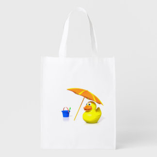 Rubber duck at the beach grocery bag