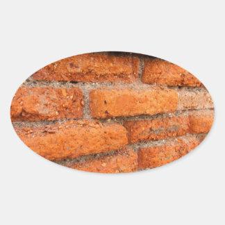 Ruddy Orange Brick Wall Oval Sticker