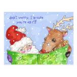 Rudolf y santa con la postal de la lista