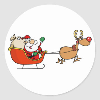 Rudolph que vuela a Kris Kringle en su trineo Pegatina Redonda