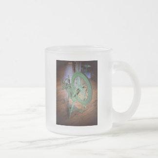 Rueda de hilado tazas de café