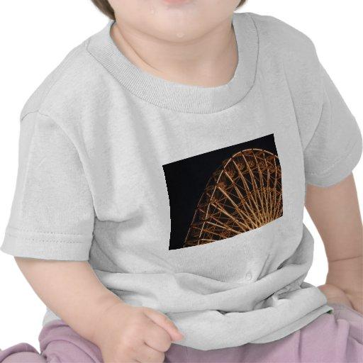Rueda de oro camisetas
