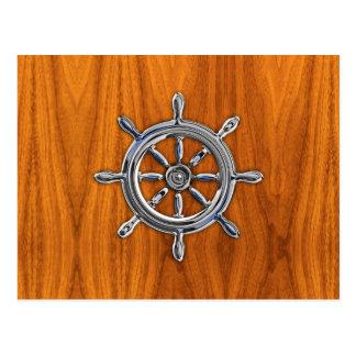 Rueda náutica en la chapa de la teca tarjeta postal