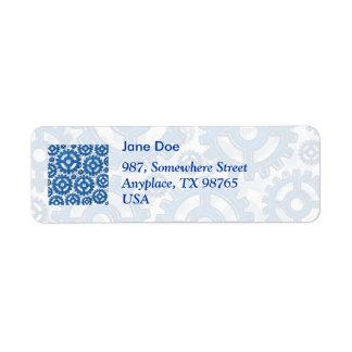 Ruedas de engranaje azules etiqueta de remitente