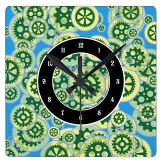 Ruedas dentadas verdes al azar reloj cuadrado