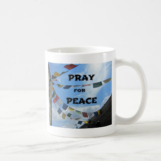 Ruegue para la paz tazas