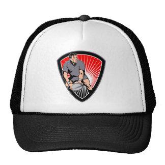 rugbi que pasa el escudo de la bola de la vista de gorras
