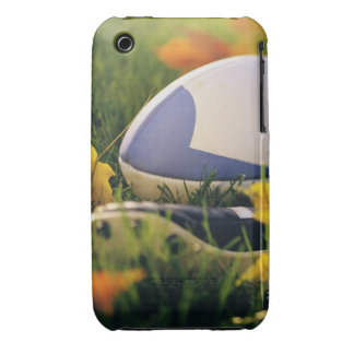 Rugby ball and shoe on lawn in autumn iPhone 3 covers
