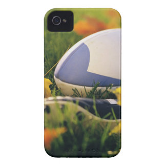 Rugby ball and shoe on lawn in autumn iPhone 4 case