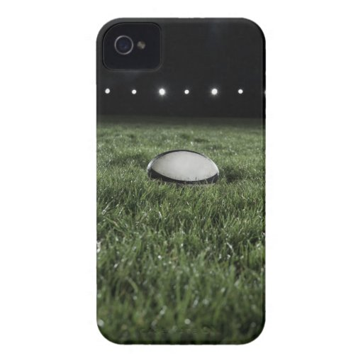 Rugby ball sitting on the grass pitch of a iPhone 4 Case-Mate cases