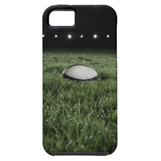 Rugby ball sitting on the grass pitch of a iPhone SE/5/5s case
