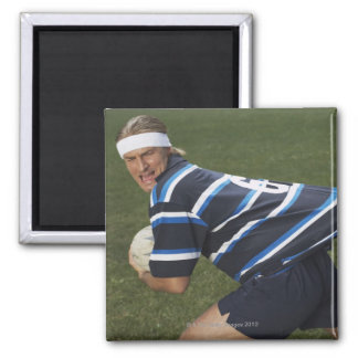 Rugby player getting shirt pulled 2 inch square magnet