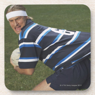 Rugby player getting shirt pulled beverage coaster
