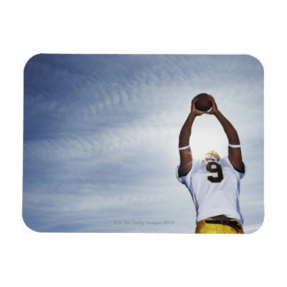 rugby player holding ball up with body stretched rectangular photo magnet