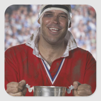 Rugby player holding trophy cup, portrait square sticker