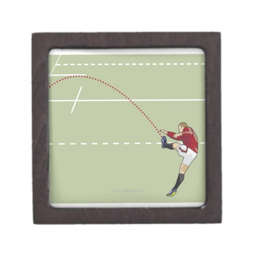 Rugby player kicking ball into touch, dotted gift box