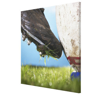 Rugby player kicking ball off tee, close up of canvas print