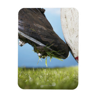 Rugby player kicking ball off tee, close up of magnet