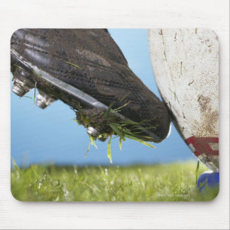 Rugby player kicking ball off tee, close up of mouse pad