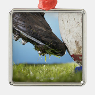 Rugby player kicking ball off tee, close up of square metal christmas ornament