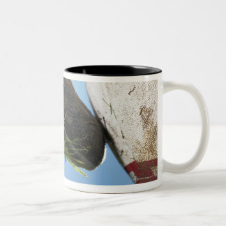Rugby player kicking ball off tee, close up of Two-Tone coffee mug