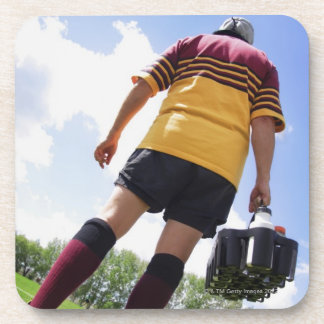 Rugby player on the sideline with refreshments beverage coaster
