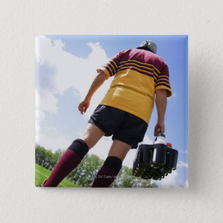 Rugby player on the sideline with refreshments button