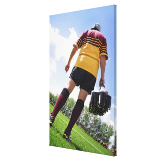 Rugby player on the sideline with refreshments canvas print