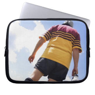 Rugby player on the sideline with refreshments laptop sleeve